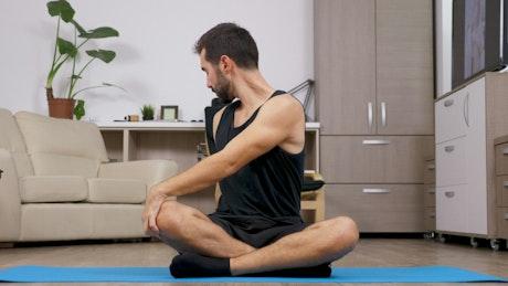 Man stretching on a mat
