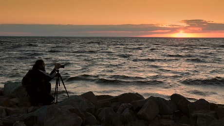 Man taking a photo of the sunset