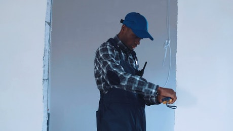 Man taking measurements in a building