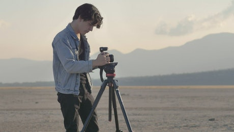 Man taking photos in a desert