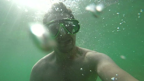 Man taking selfies while diving in the sea