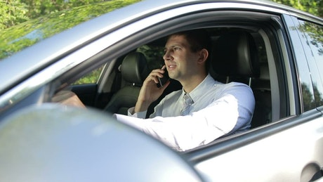 Man talking on his cell while in his car
