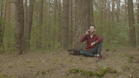 Man talking on the phone in a forest