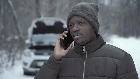 Man talking with helpline about broken car