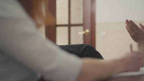 Man talks to therapist in addiction center