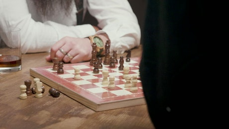 Man thinking about next chess move gets checkmate