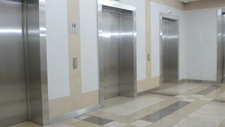Man tries broken elevator button in office
