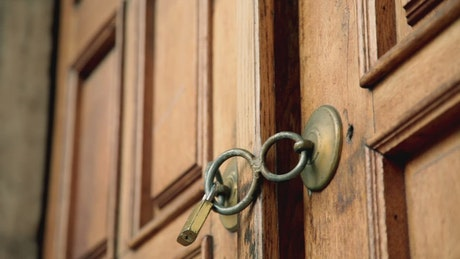 Man tries to open a padlocked wooden door