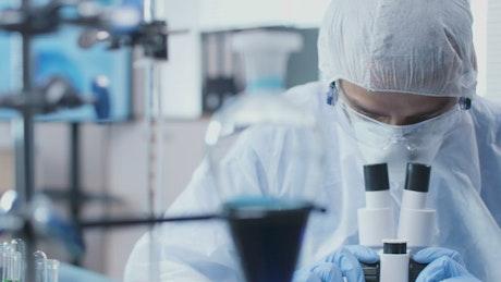 Man using a microscope