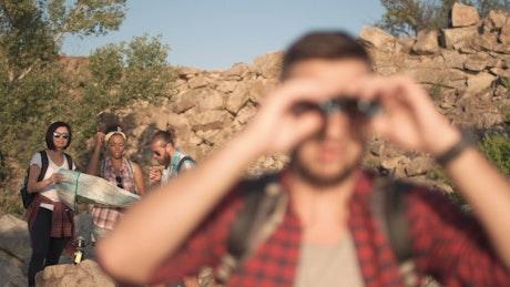 Man using binoculars in the wild