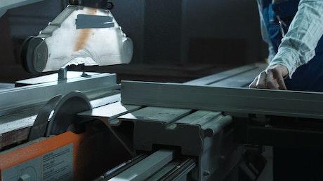 Man using cutting machine in the workshop