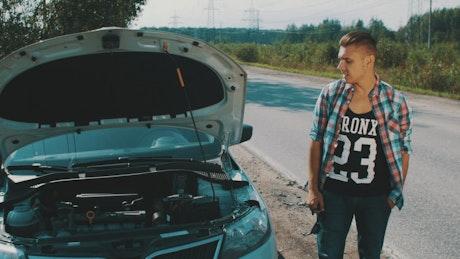 Man waits by his broken car