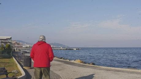 Man walking by the ocean