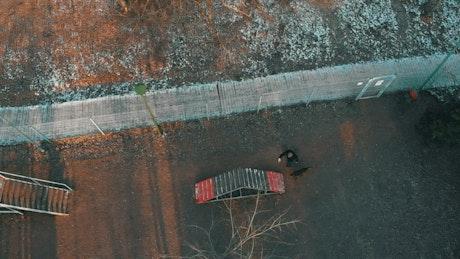 Man walking his dog in a park, aerial shot