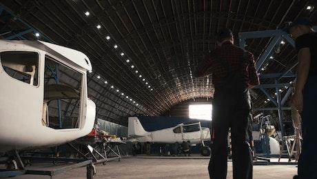 Man walking in an aircraft hangar
