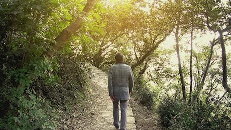 Man walking in an autumn garden