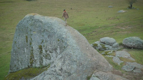 Man walking on a giant stone