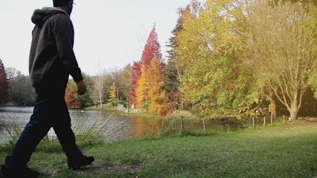 Man walking on a park in autumn