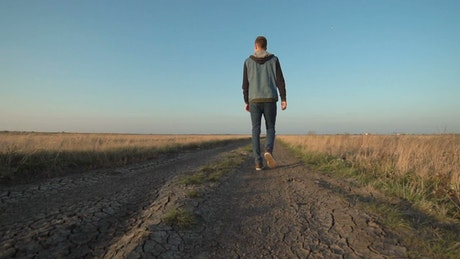 Man walking on a rural road
