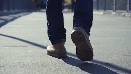 Man walking on the concrete sidewalk