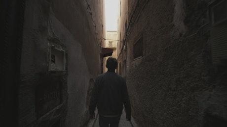 Man walking through the narrow streets of Morocco