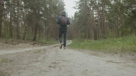Man walking through the woods