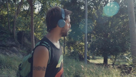 Man walking with music in nature