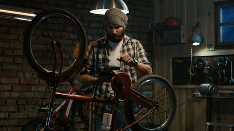 Man watching a tutorial to repair a bike