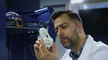 Man watching that 3-D printer skull