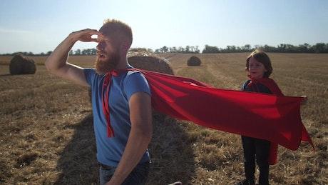 Man wearing a cape