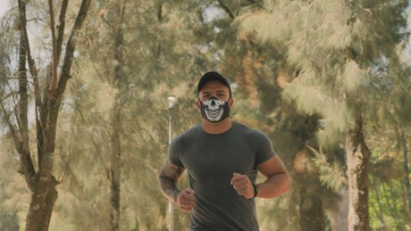 Man wearing face mask while jogging