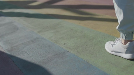 Man with a rainbow flag in the street