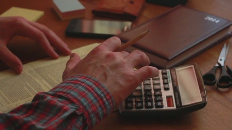 Man with calculator and legal documents
