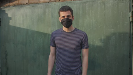 Man with mask keeping distance