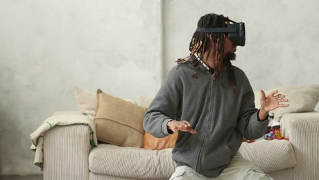Man with virtual reality glasses doing gestures