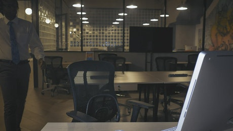Man working in an office at night