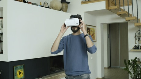 Man working in virtual reality at home