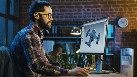 Man working on a video game model in the office