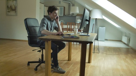 Man working on customer support at home