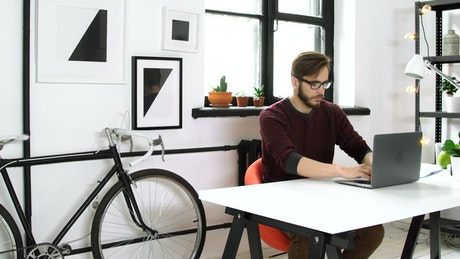 Man working on his laptop on a startup environment