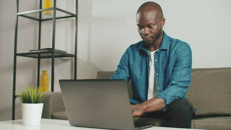 Man working on his laptop remotely