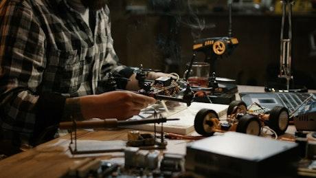 Man working on repairing drone circuits