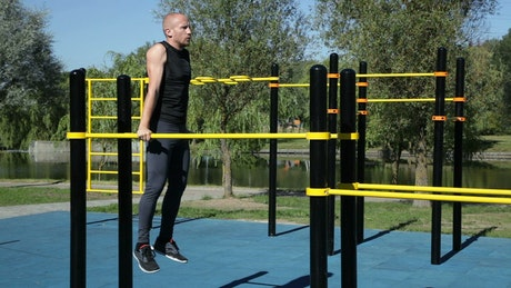 Man working out at a park gym
