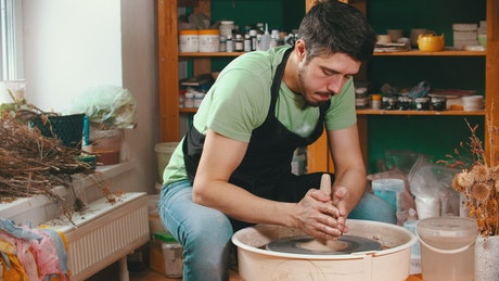 Man working with clay in the pottery studio
