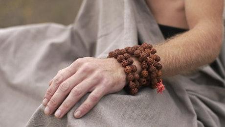 Man's hands when starting meditation