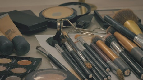 Many makeup items on a table