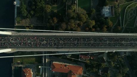 Marathon runners crossing a bridge