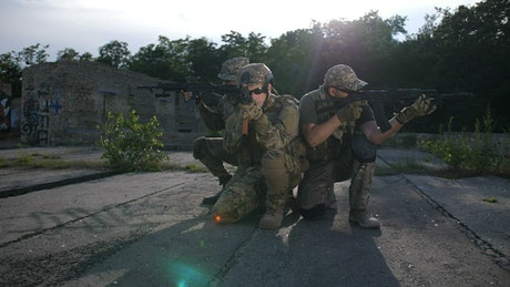 Marines aiming their weapons