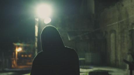 Masked man roaming street