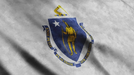 Massachusetts state flag waving by the wind